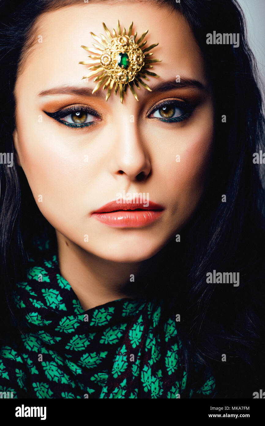 beauty eastern real muslim woman with jewelry close up, bride wi - Stock Image
