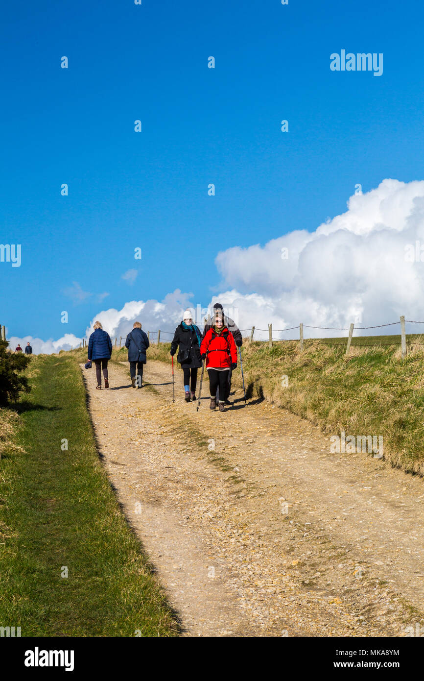 Walkers on a the track from Ringstead Bay to White Nothe Point on the Jurassic Coast Path. Dorset, England, UK - Stock Image