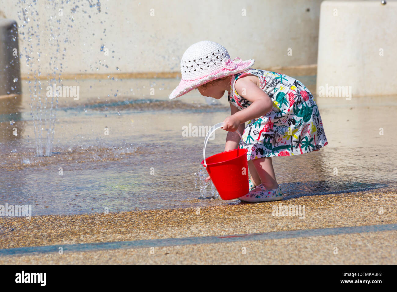 Bournemouth, Dorset, UK. 7th May 2018. UK weather:  Young girl cooling down playing in the water feature at Pier Approach on a hot and sunny May Bank Holiday Monday. Credit: Carolyn Jenkins/Alamy Live News Stock Photo