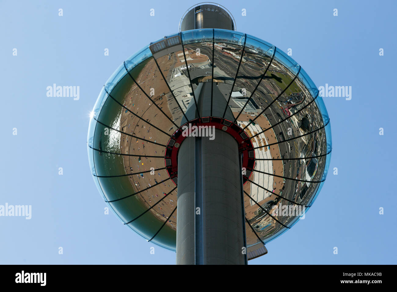 Brighton & Hove Beach, East Sussex, UK. 7th May 2018. Brighton & Hove Beach Bank Holiday as tempretures reach record levels for a early May holiday weather. This image captured the reflection from underneath the I360 Tower.City of Brighton & Hove Beach, East Sussex, UK. 7th May 2018 Credit: David Smith/Alamy Live News - Stock Image