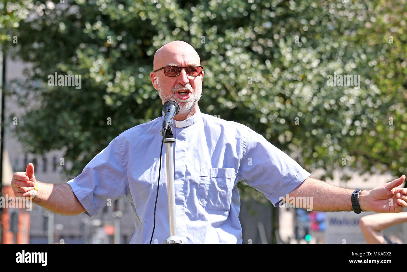 Salford, UK. 7th May, 2018. Andy Salmon, Rector, welcomes workers at the Sacred Trinity Church on International Workers Day, often referred to as May Day or Labour Day, which is a celebration of  the working class, Salford,7th May, 2018 (C)Barbara Cook/Alamy Live News - Stock Image