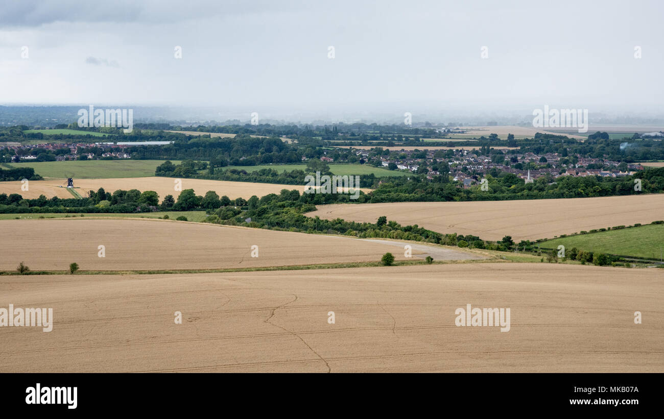 A downpour of rain shrouds villages in the agricultural landscape of Aylesbury Vale in Buckinghamshire, England, with Ivinghoe Windmill standing in fi - Stock Image