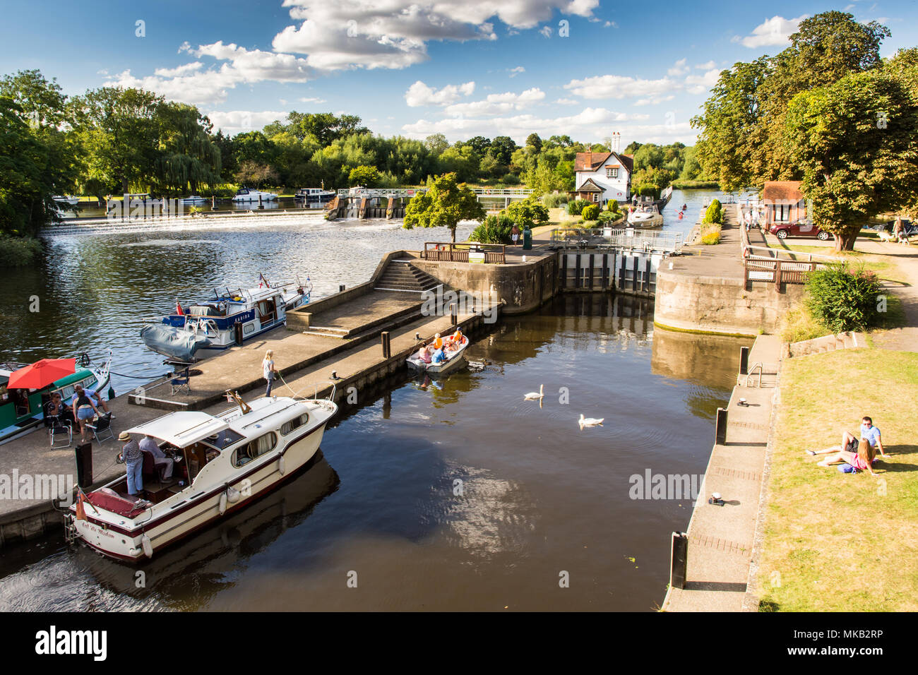 Reading, England, UK - August 29, 2016: The weir and lock on the River Thames at Goring in Oxfordshire. Stock Photo