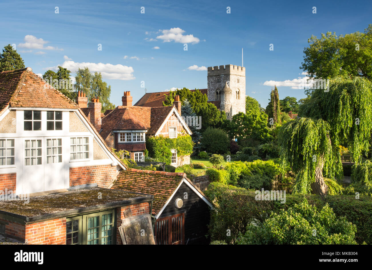 Reading, England, UK - August 29, 2016: Traditional cottages and parish church beside the River Thames in the village of Goring, Berkshire. - Stock Image