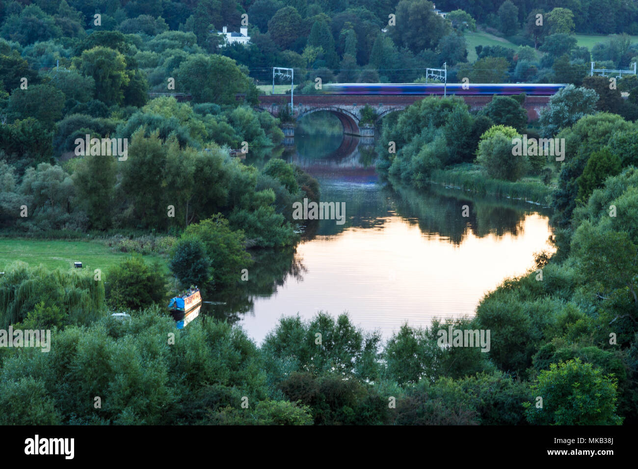 Reading, England, UK - August 29, 2016: Thames Turbo diesel multiple units crossing the River Thames at Goring Gap in Berkshire, under new electrifica - Stock Image