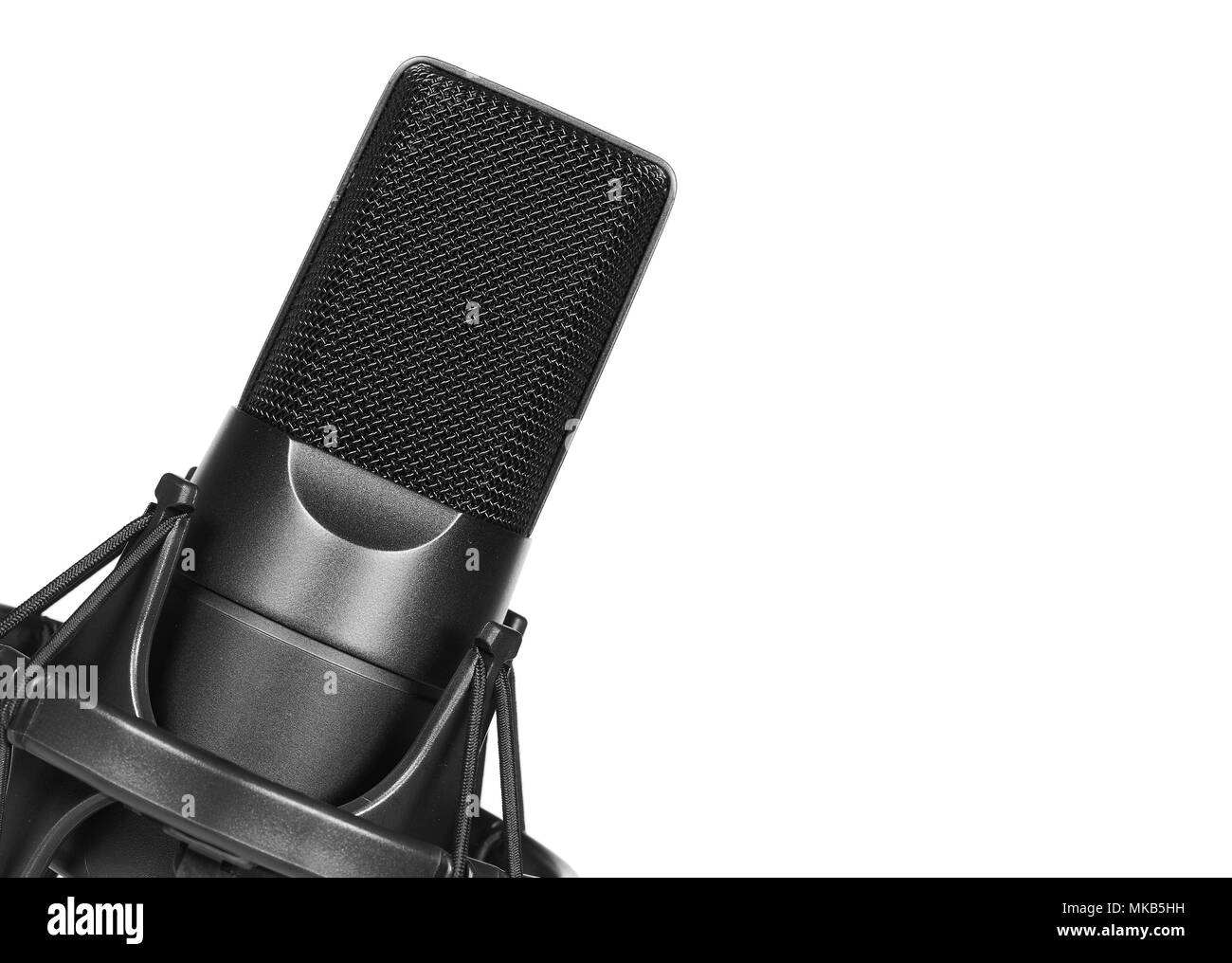 Studio condenser microphone close up. isolated on white background - Stock Image