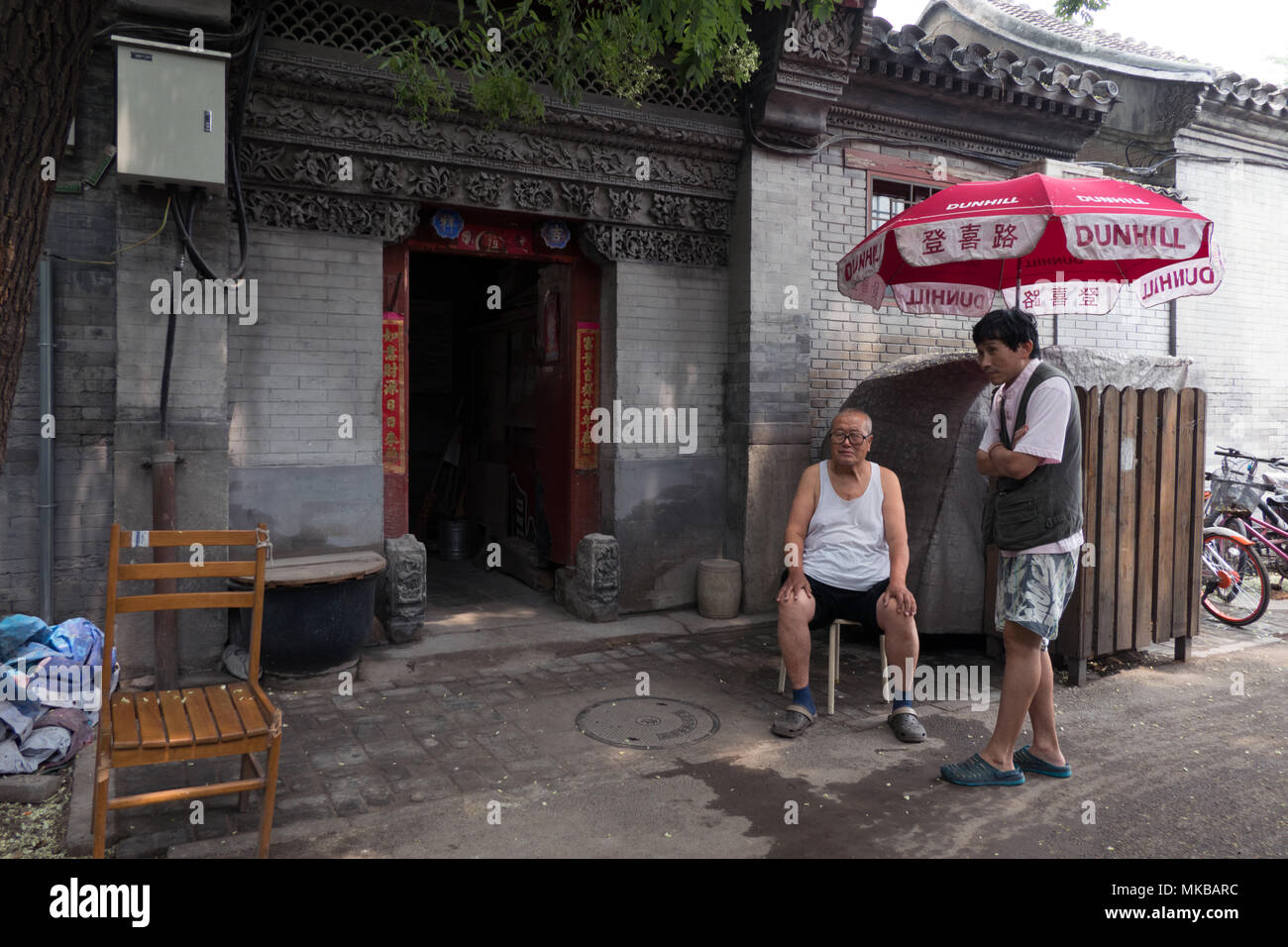 Daily life in a hutong (traditional old narrow street) of Beijing, China, Asia - Stock Image