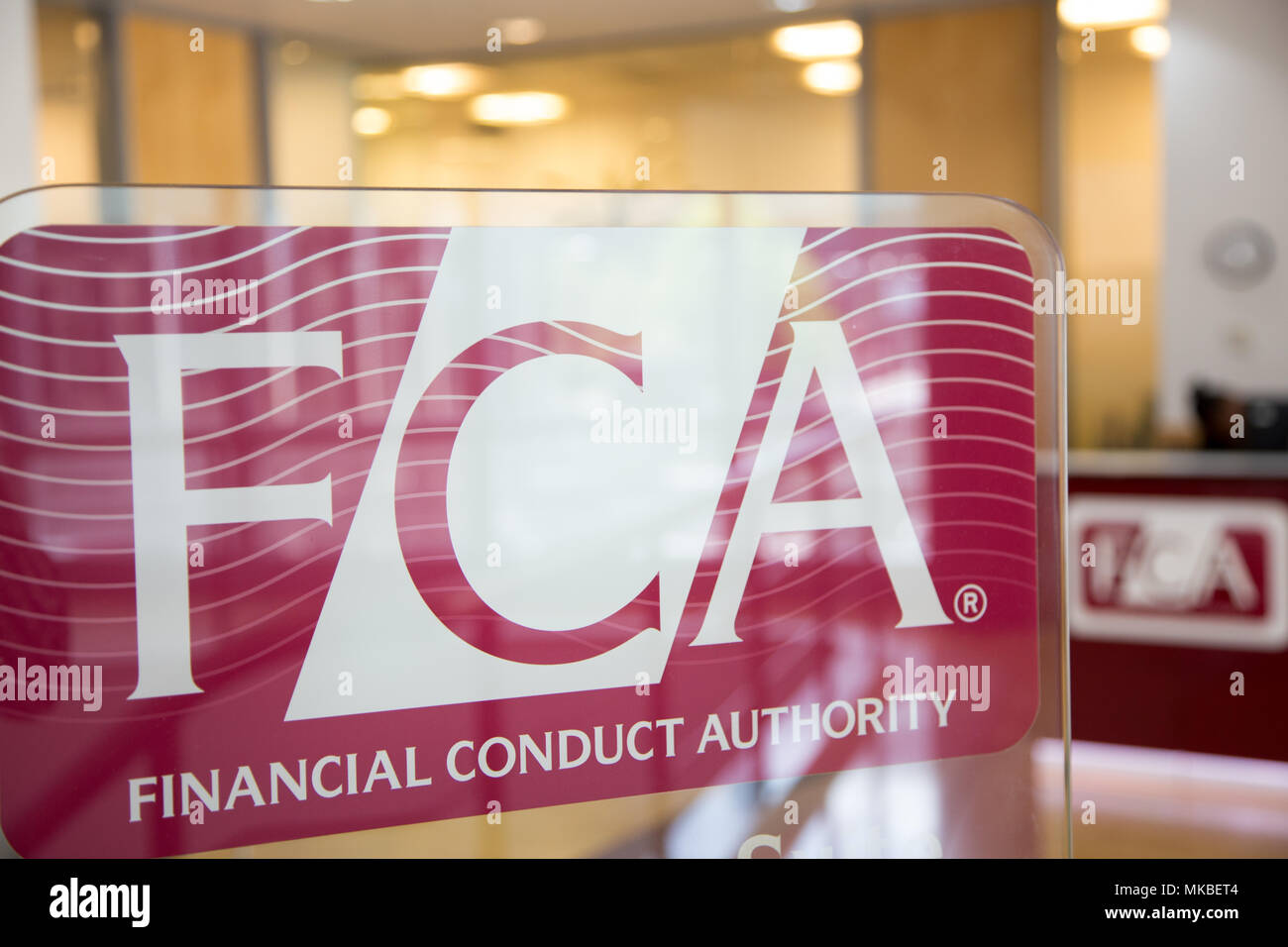 Financial Conduct Authority (FCA) offices, North Colonnade, Docklands, London. Upstairs reception showing corporate logo - Stock Image