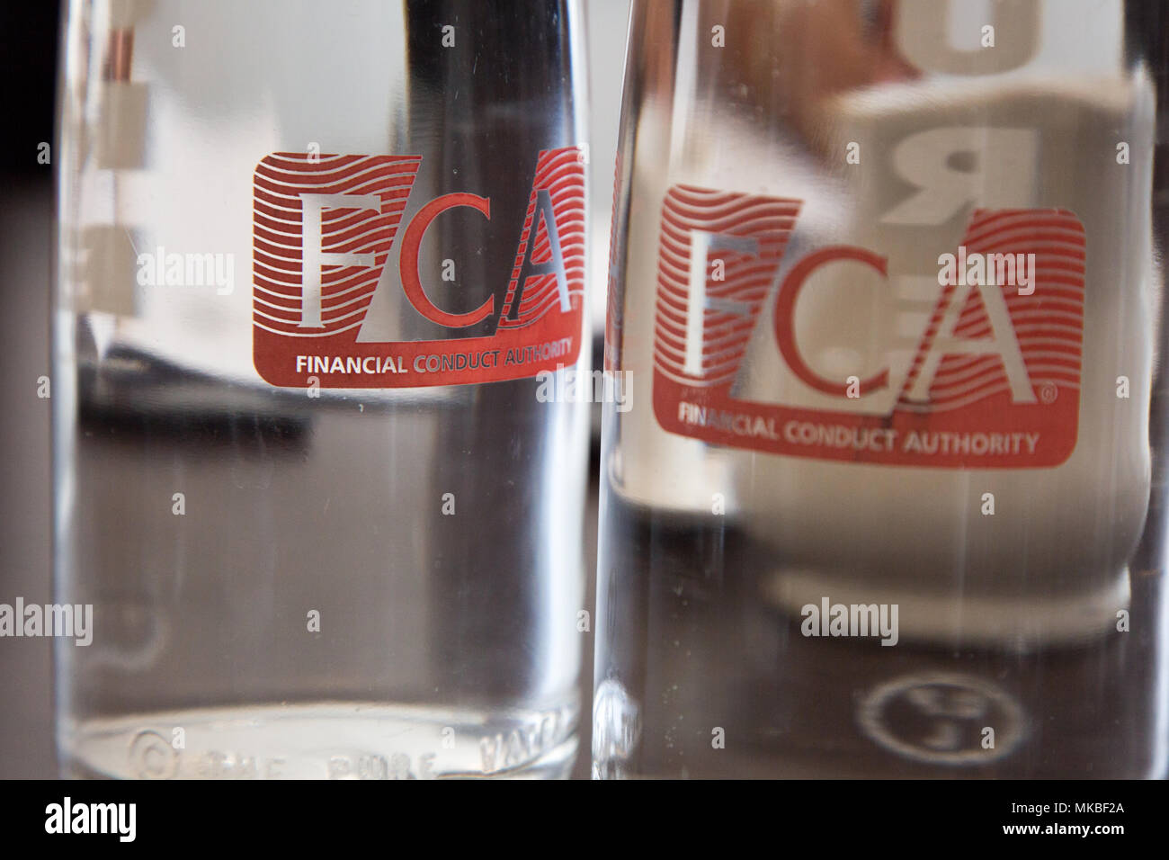 Water bottles at the Financial Conduct Authority (FCA) offices, North Colonnade, Docklands, London. Logo corporate branding is clearly displayed - Stock Image