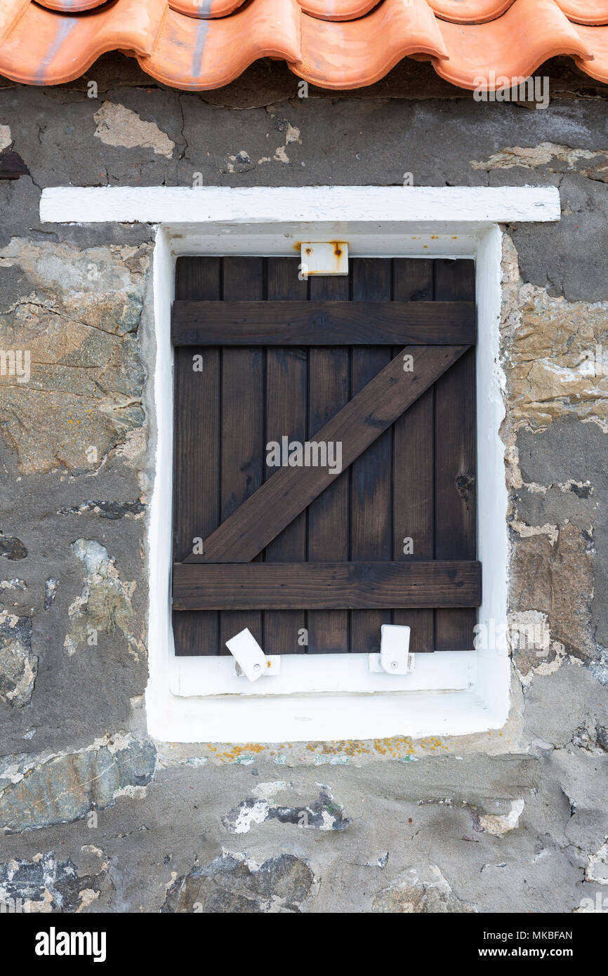Wooden window shutter on a cottage in the fishing village of Crovie, Aberdeenshire, Scotland,UK Stock Photo