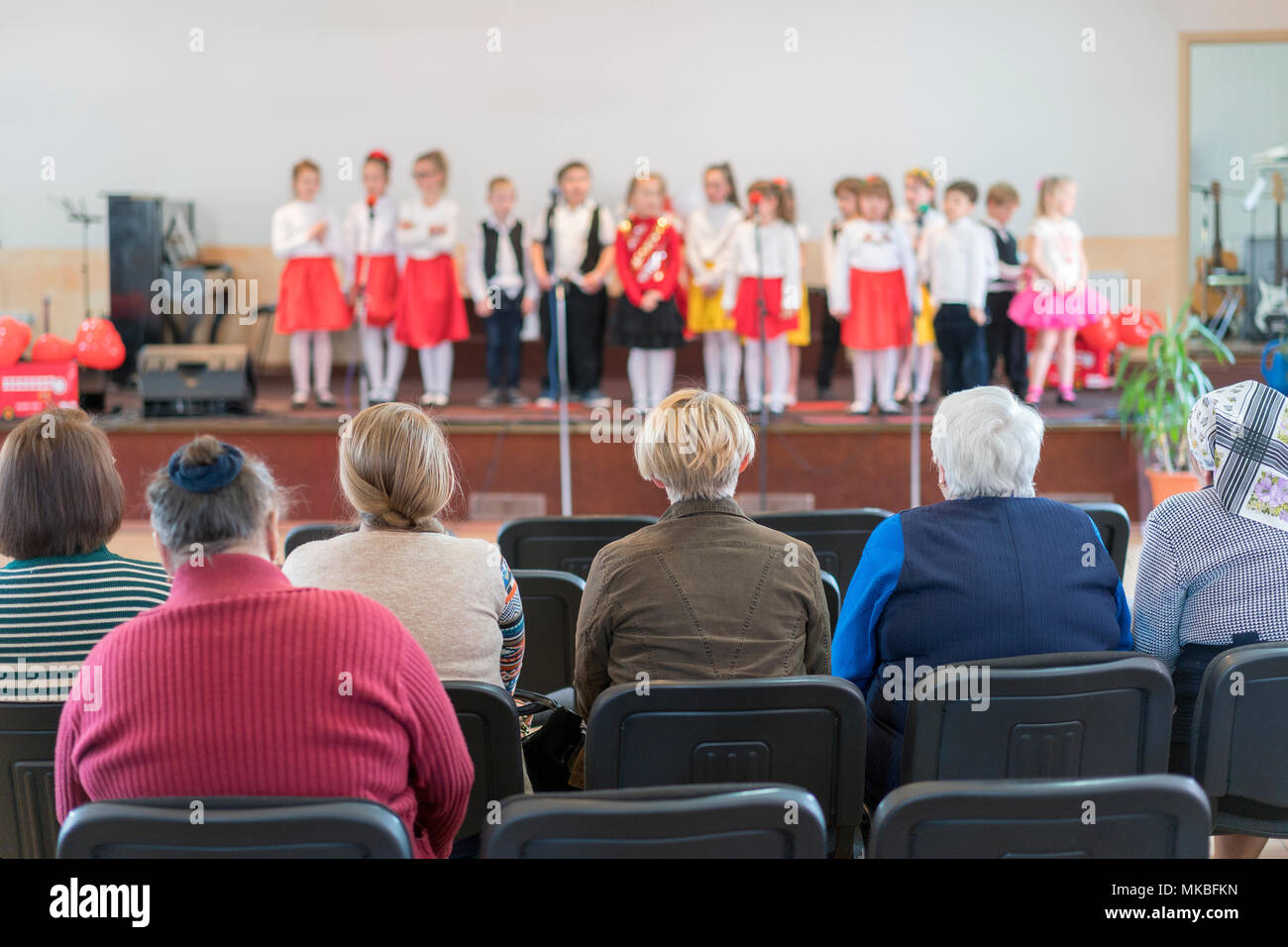 image of blur kid 's show on stage at school , for background usage - Stock Image