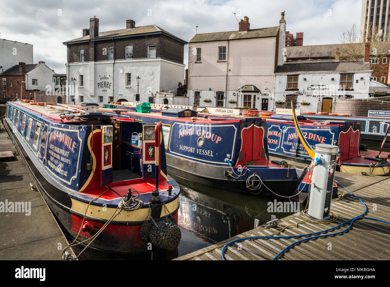Colourful narrow canal boats on Gas Street Basin - Stock Image