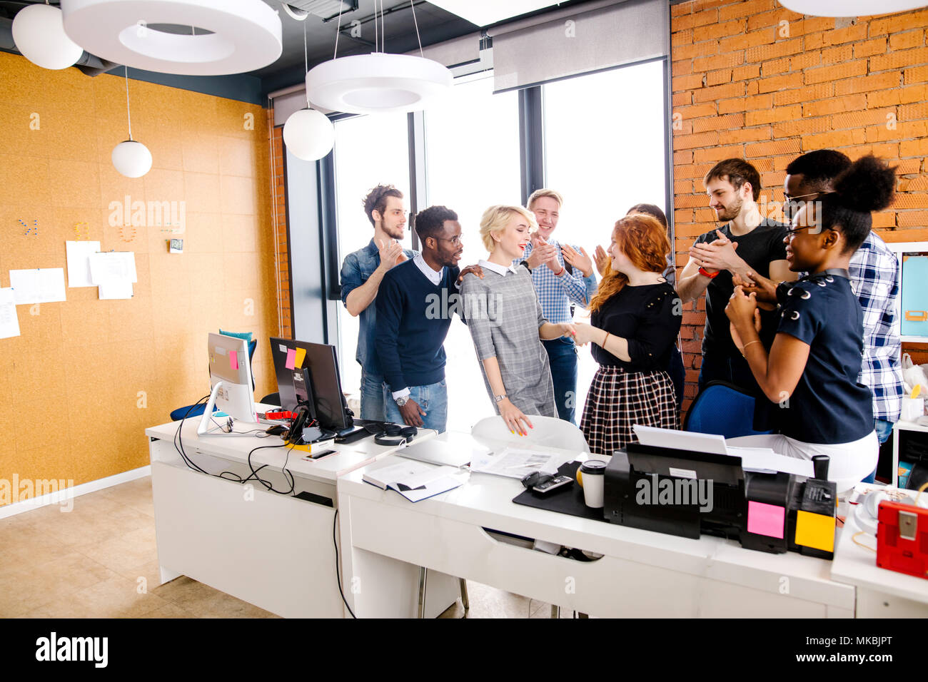 office workers are thanking their boss for high salary and premium in the loft office - Stock Image