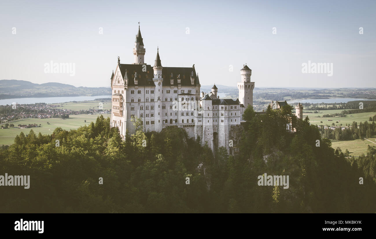 Beautiful view of world-famous Neuschwanstein Castle, the 19th century Romanesque Revival palace built for King Ludwig II, in evening light at sunset  - Stock Image