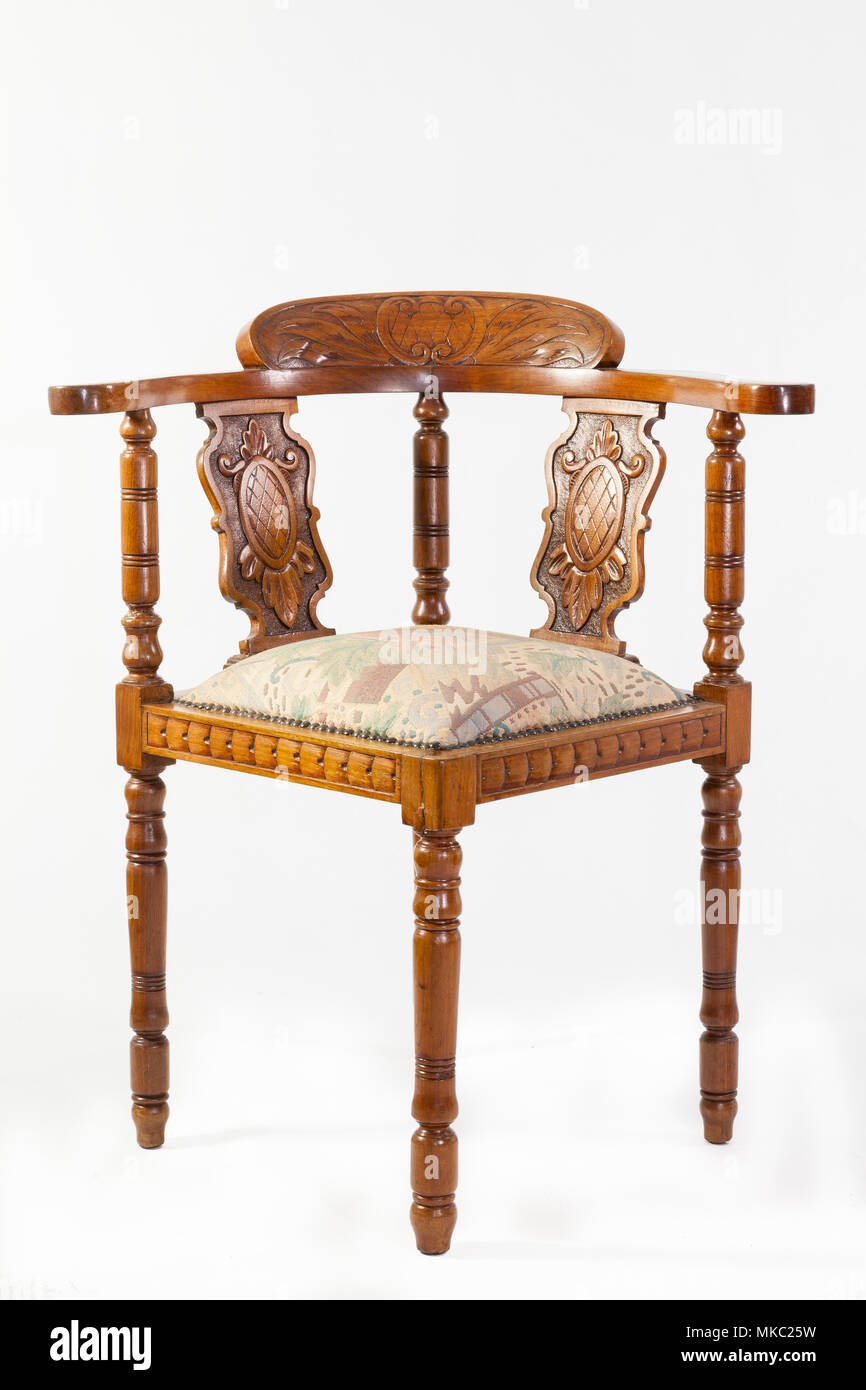 Antique 19th Century Fruitwood Captains Chair Or Corner Chair With An  Upholstered Seat And Handcarved Detail Over A White Background