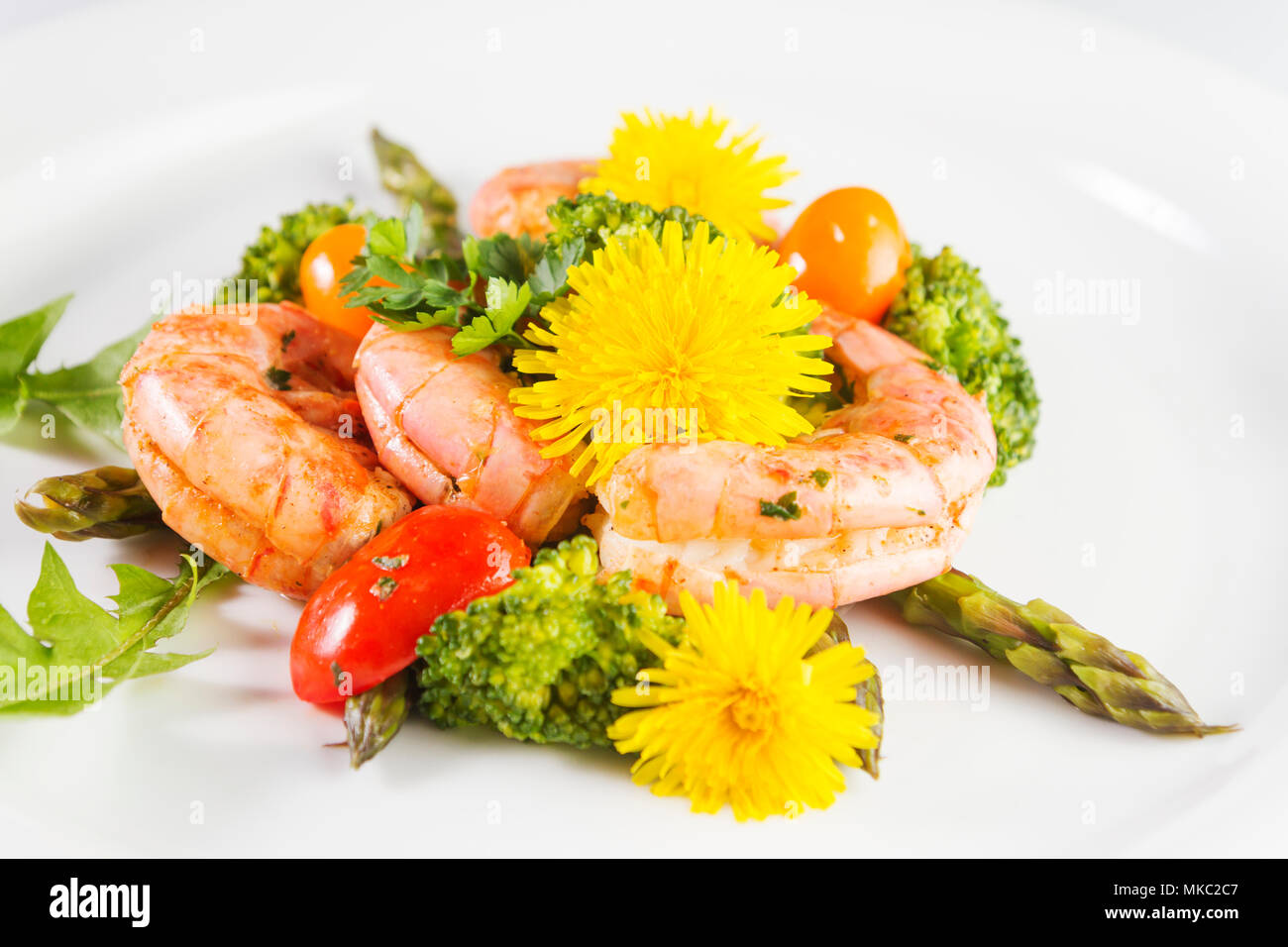 Prawns Asparagus And Broccoli With Edible Dandelion Flowers