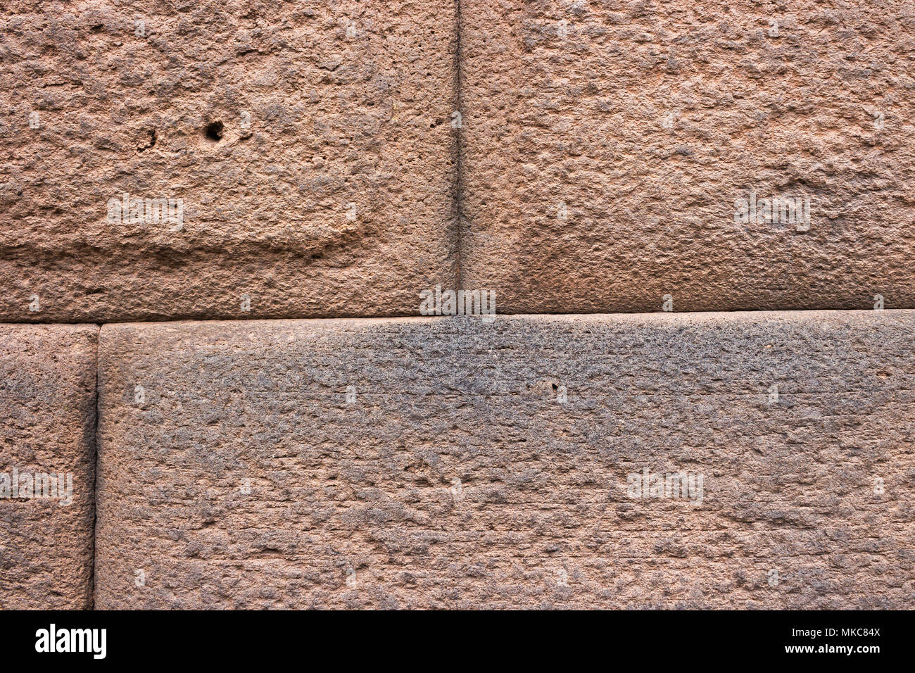 Close-up Detail of Inca Ashlar Wall Precise Stone Block Jointing, Cusco, Peru - Stock Image