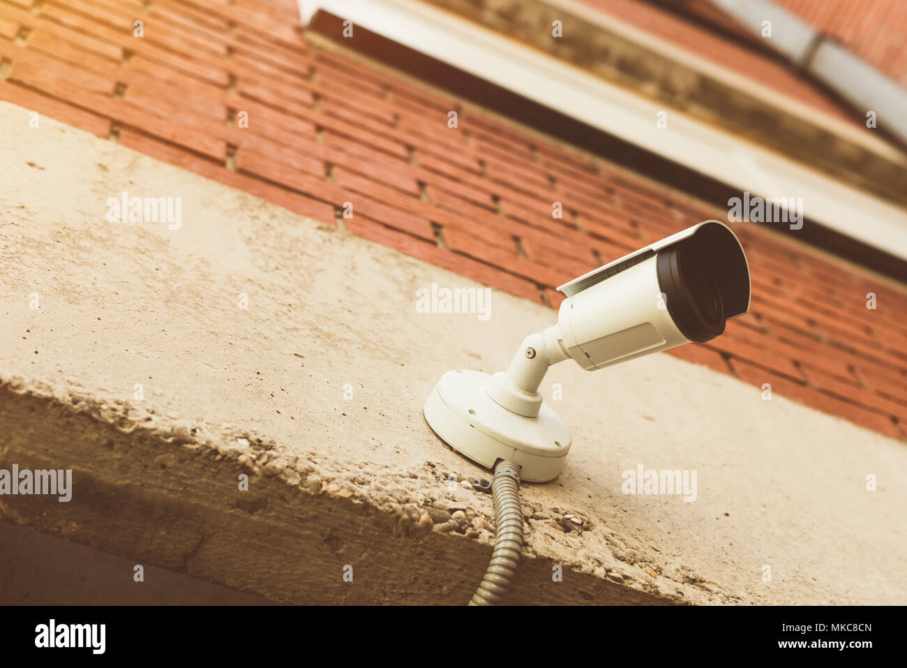 Home protection security camera mounted on house exterior wall for surveillance purposes - Stock Image