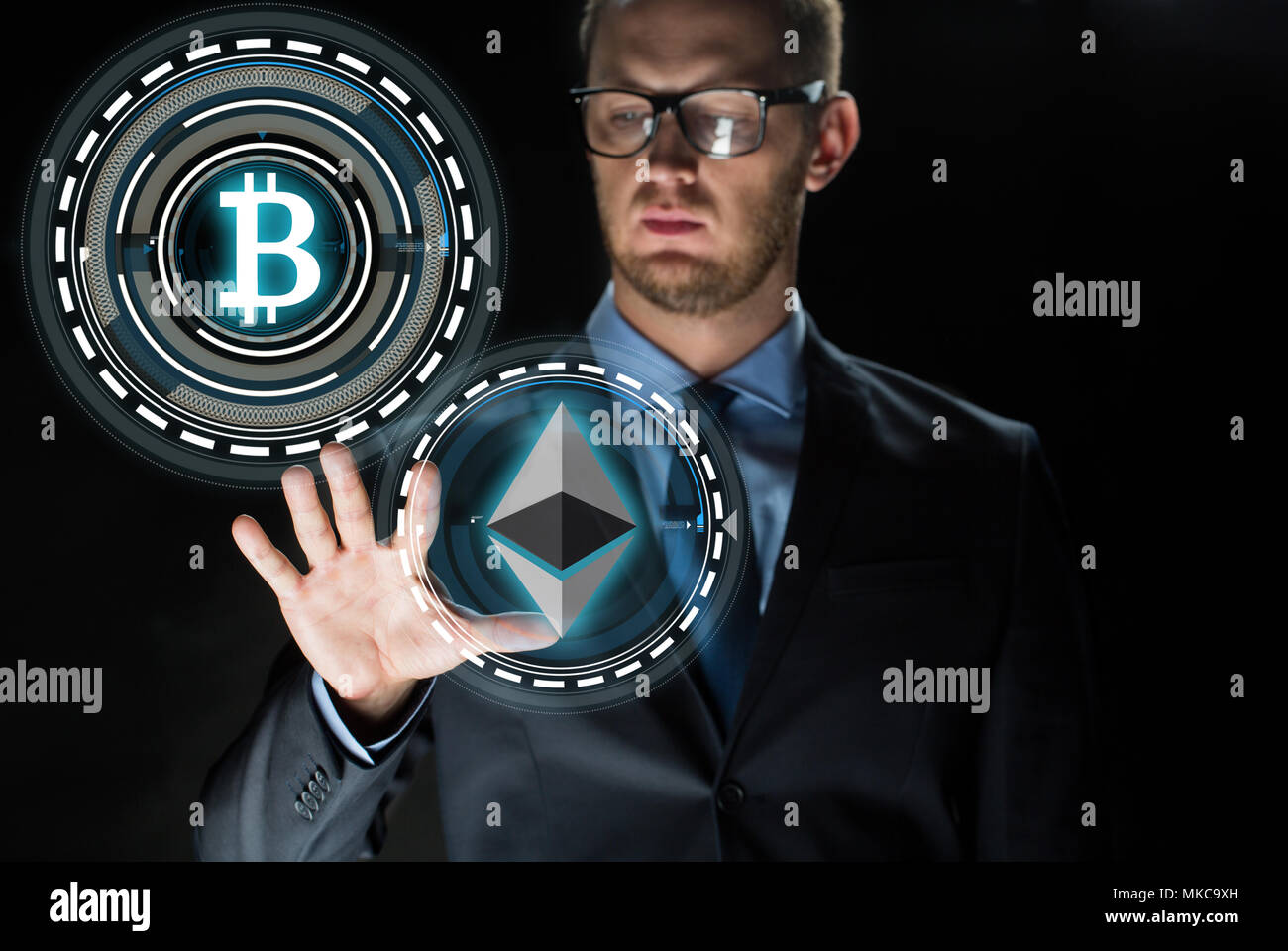 businessman with cryptocurrency holograms - Stock Image