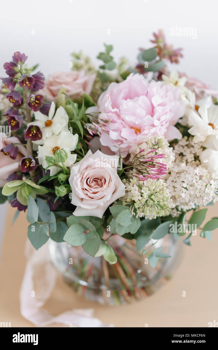 Wedding Bouquet Of White Lilac Roses Peony And Buttercup On A Wooden Table Lots Of Greenery Modern Asymmetrical Disheveled Bridal Bunch Spring Flowers Stock Photo Alamy