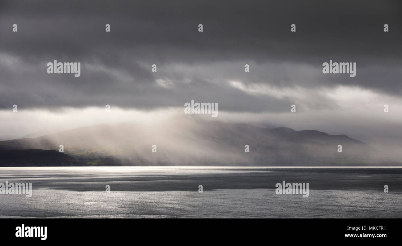 Clearing storm over the  Iveragh Peninsula  and the Macgillycuddy's Reeks, County Kerry Ireland - Stock Image