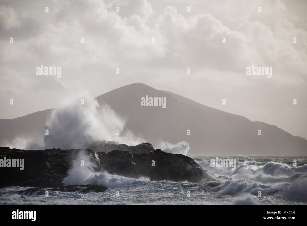 Waves breaking on the coastline of Achill Island County Mayo Ireland with Clare Island in the background. - Stock Image