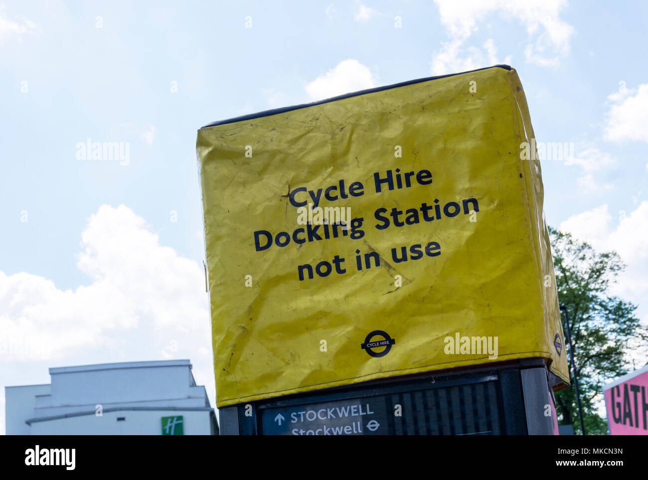 Sign on a London cycle hire docking station that is out of use. - Stock Image