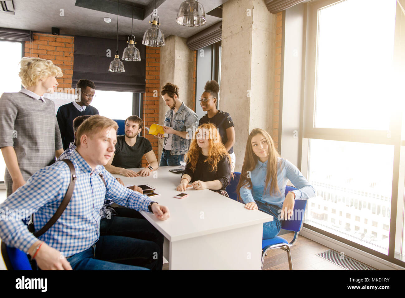 multicultural students activist forming group in consultation in the loft office building - Stock Image