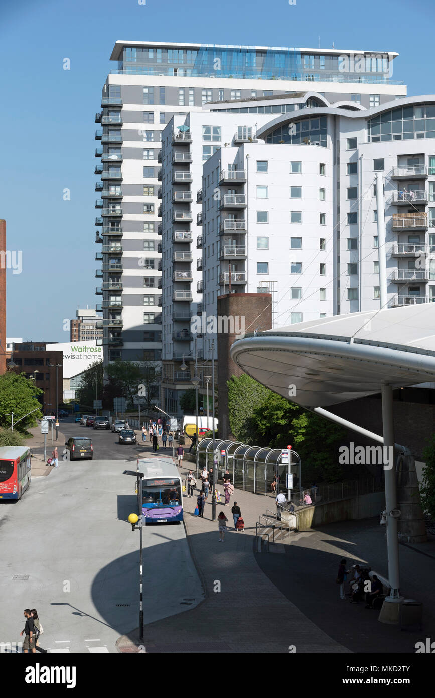 Basingstoke, Hampshire, England UK. 2018. Apartment blocks in the town centre and bus stop for local journeys outside the Malls entrance - Stock Image