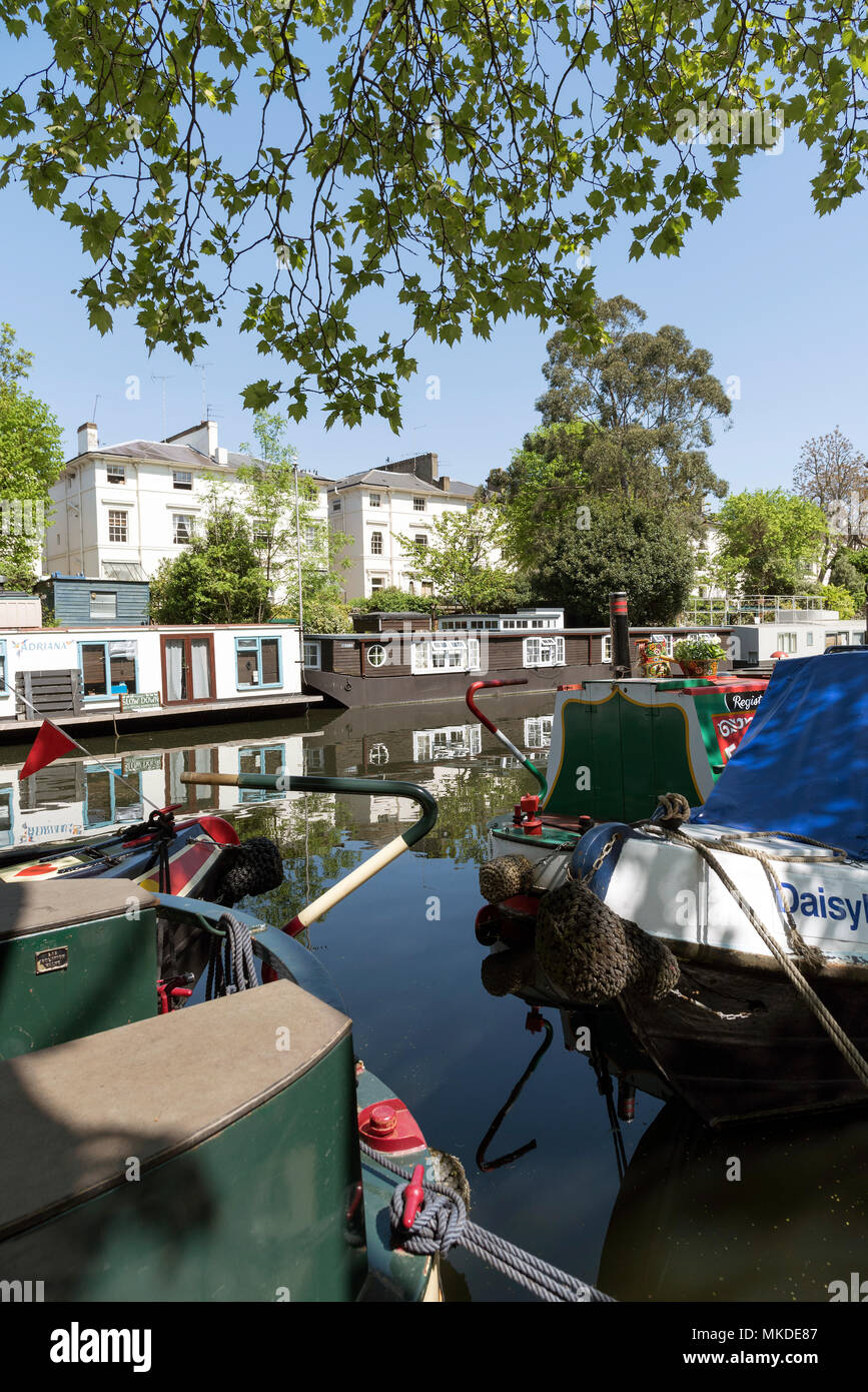 West London UK. 2018. floating homes on the Paddington Arm of the Grand Union Canal in Little Venice. The Grand Union Canal at Little Venice. - Stock Image
