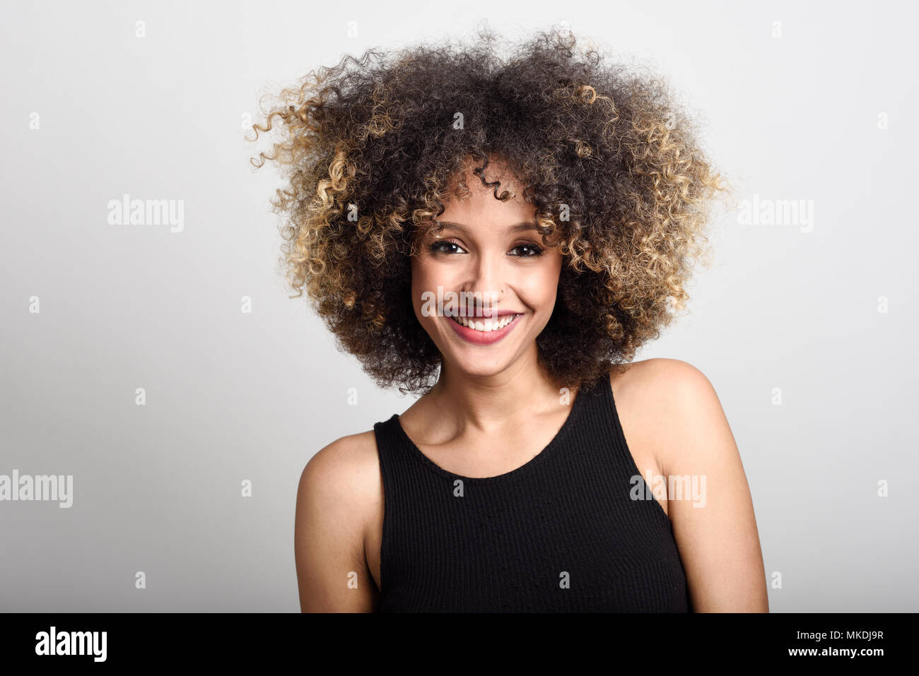 Young Black Woman With Afro Hairstyle Smiling Girl Wearing Black