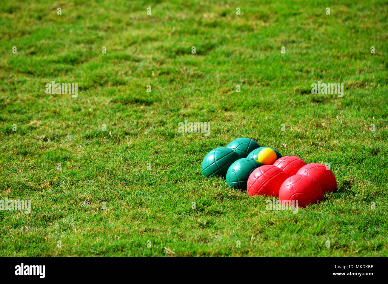Boules bocce game balls on grass - Stock Image