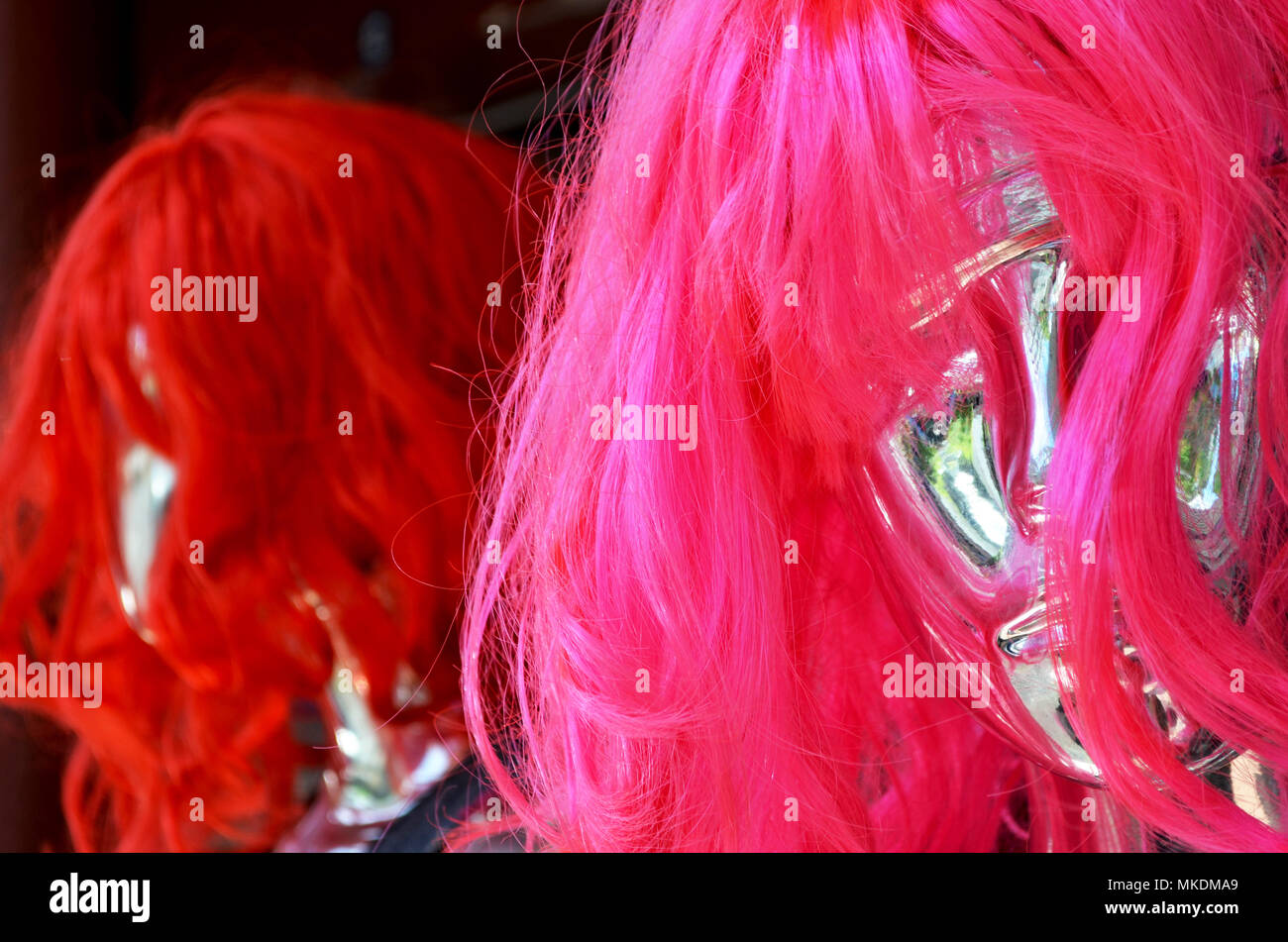 Wigs on a mannequin head - Stock Image