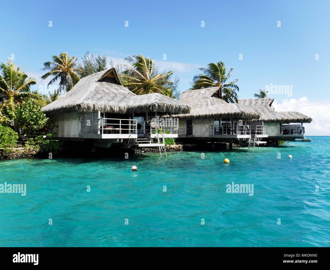 Water bungalows over ocean. Moorea, Tahiti Polynesia - Stock Image