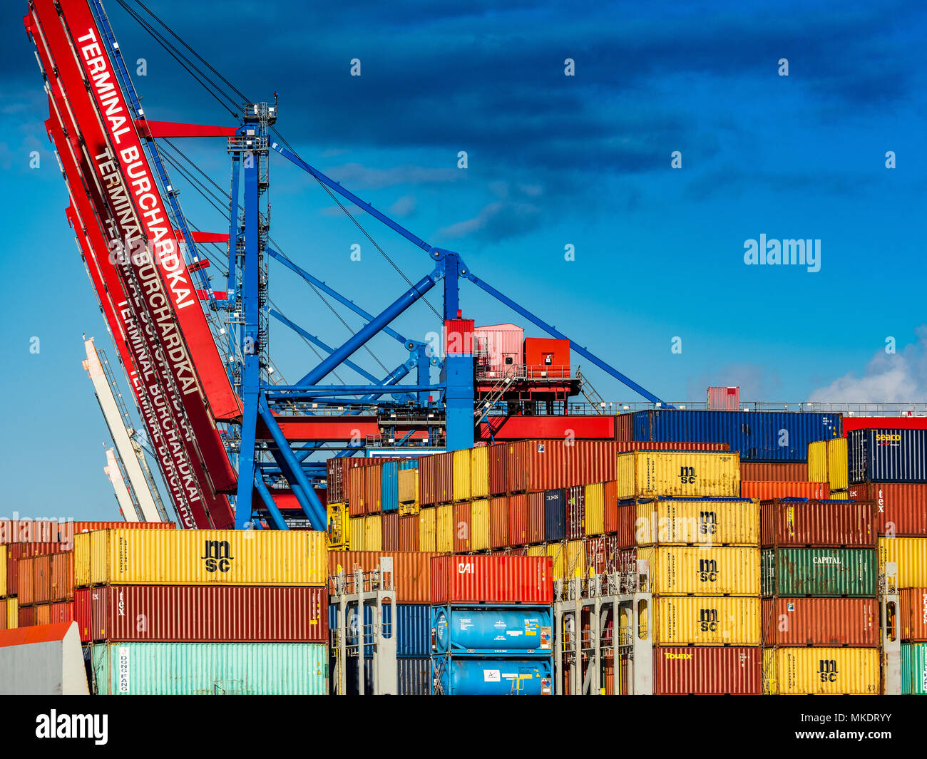 Global Trade World Trade International Trade - containers arrive in Hamburg Port, one of Europe's largest ports. - Stock Image
