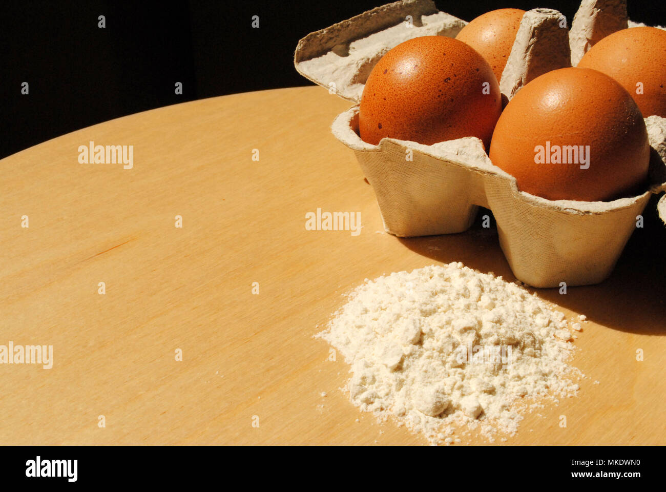 A close-up of baking ingredients and equipment. - Stock Image