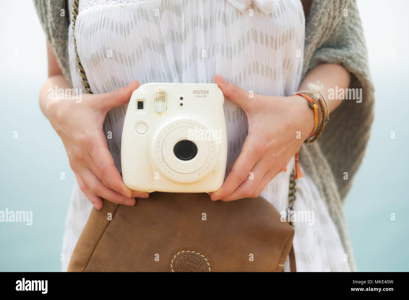 Making memories with instax camera - Stock Image