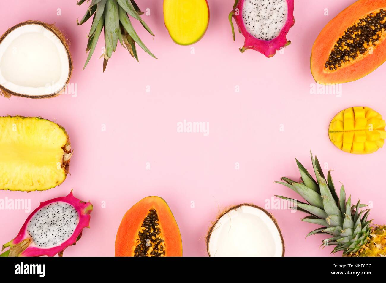 Tropical fruit frame with pineapple, dragon fruit, papaya, coconut ...
