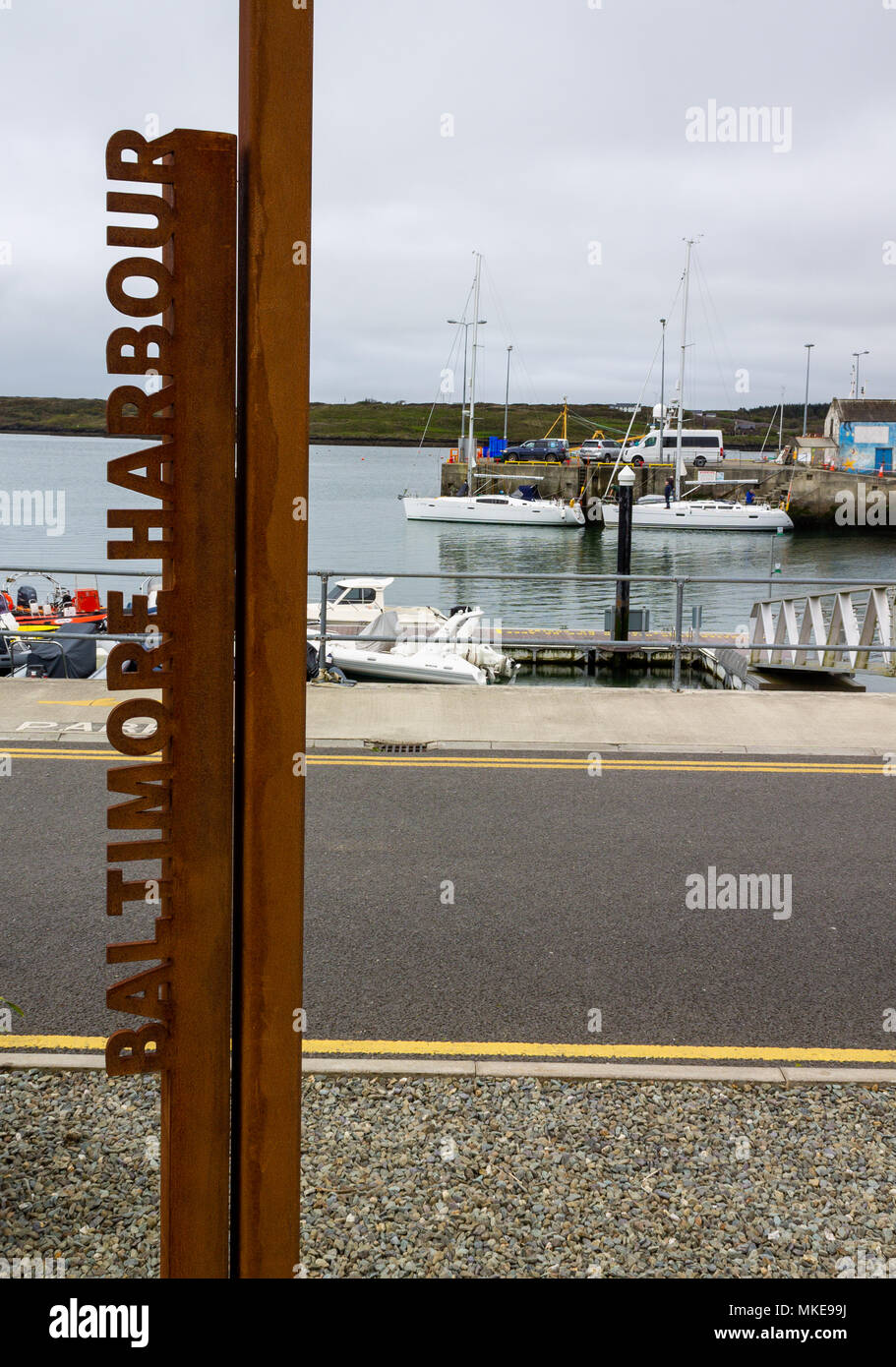 sign made out of metal letters spelling baltimore harbour, Ireland and allowed to rust in the salt sea air. - Stock Image
