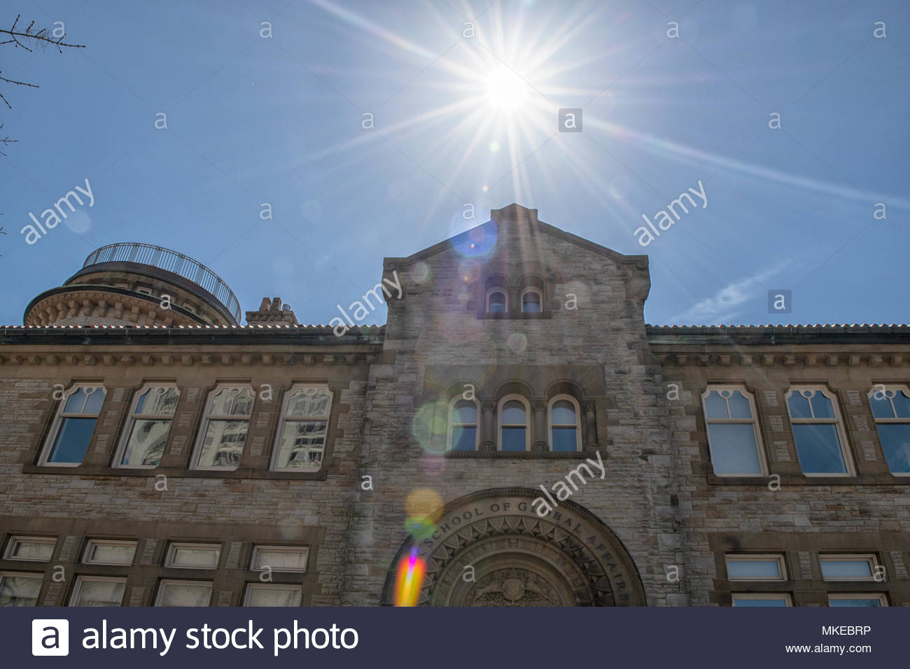 Munk School of Global Affairs, facade or entrance to the old architecture building located in Bloor Street West. The sun is in the blue clear sky - Stock Image