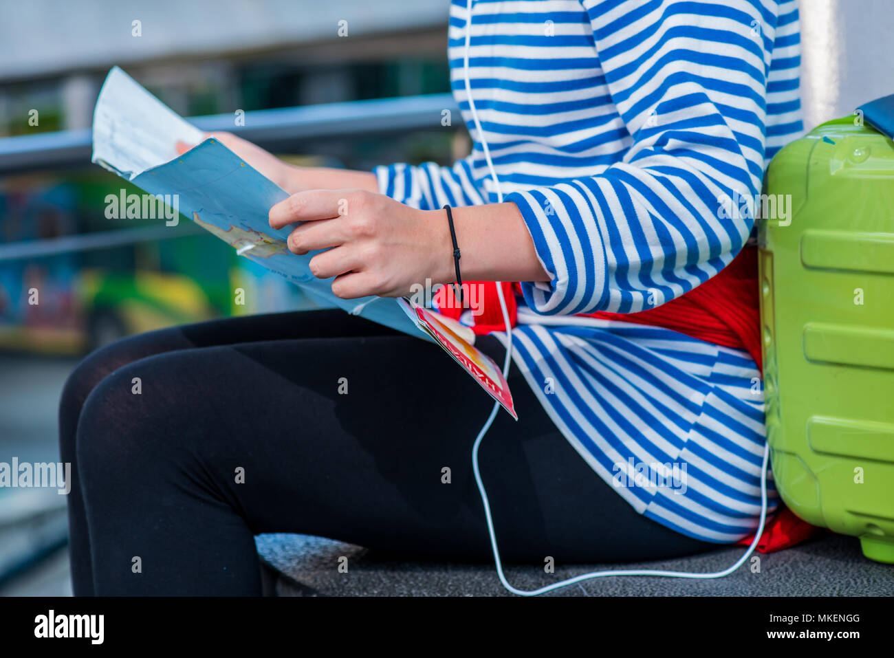 Teenager travel in Bangkok Thailand. Lose the way and looking the map. - Stock Image