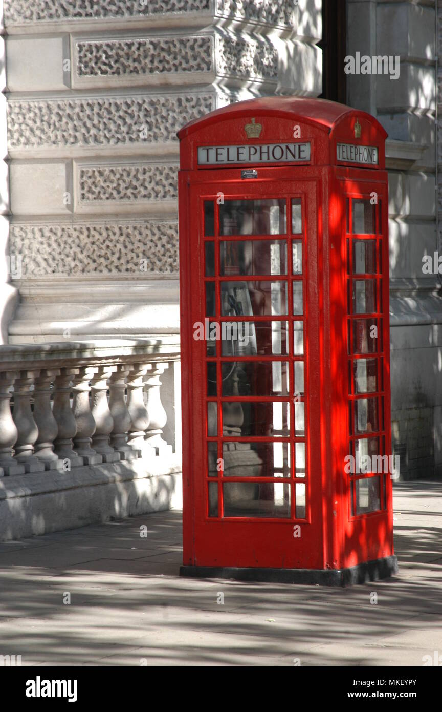 The iconic London bright red phonebox as still seen on many London city streets - Stock Image
