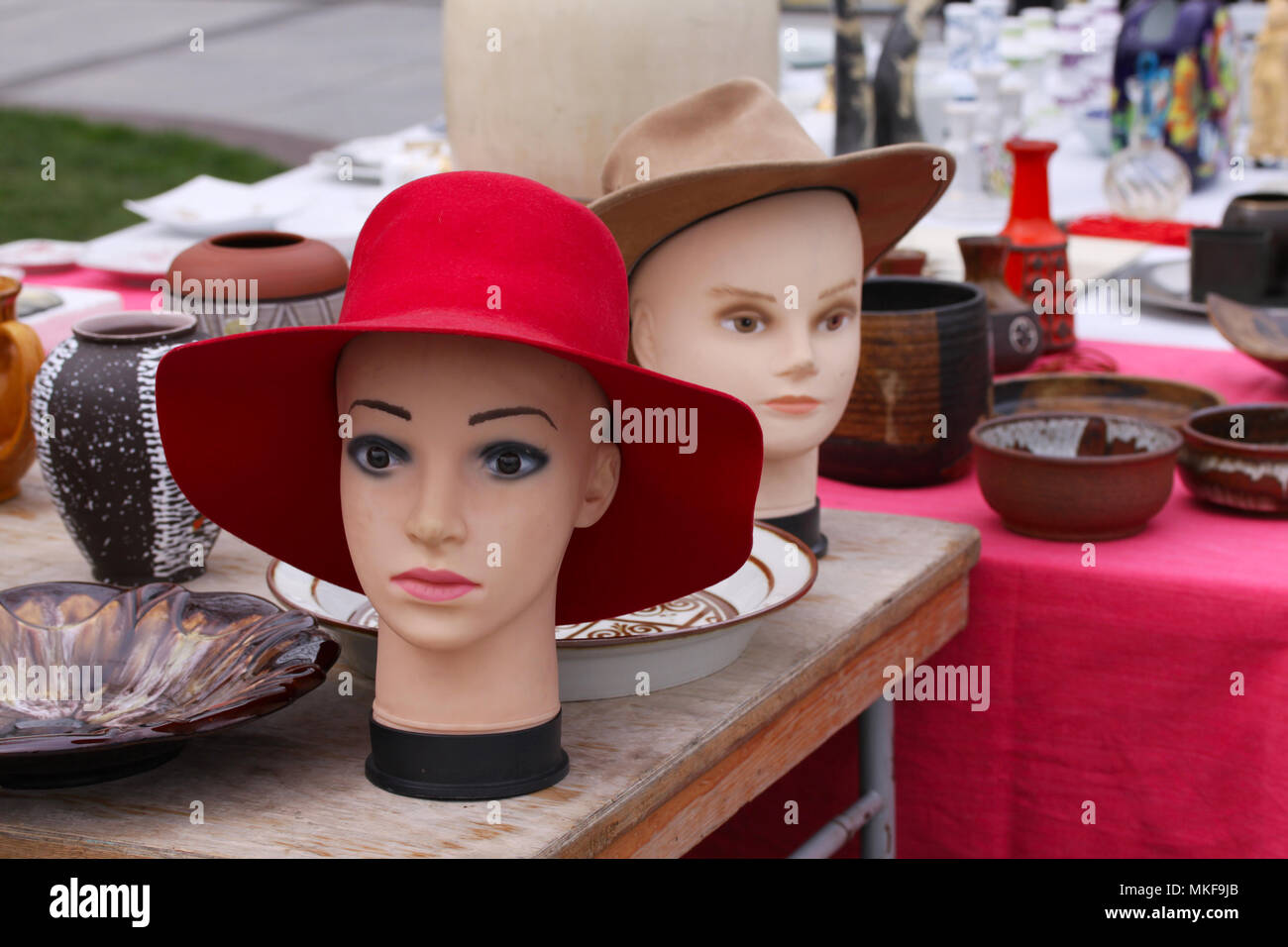 Scene from Flea market where people sell and buy used hats toys, clothes, pictures, kitchen ware and other vintage things Stock Photo