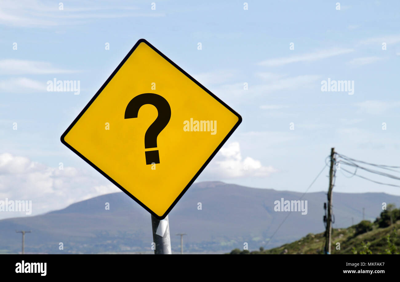 Yellow road warning sign with question mark - Stock Image