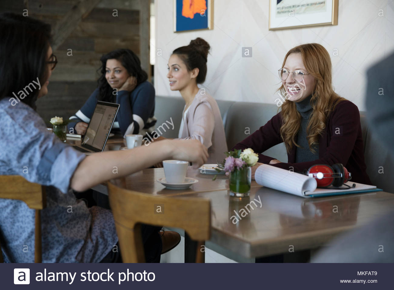 Smiling young couple talking in cafe Stock Photo