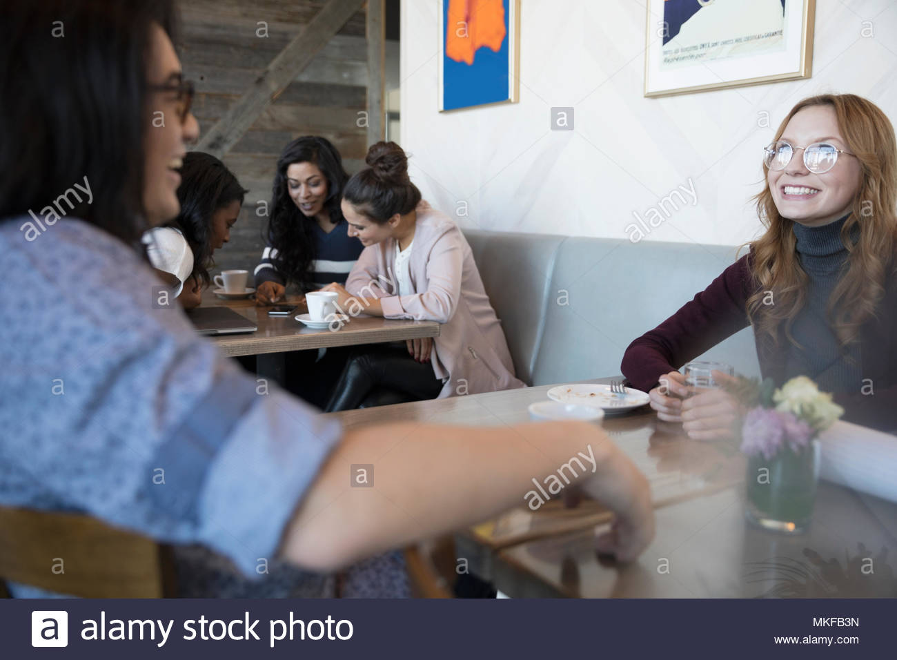 Smiling, happy couple talking in cafe Stock Photo