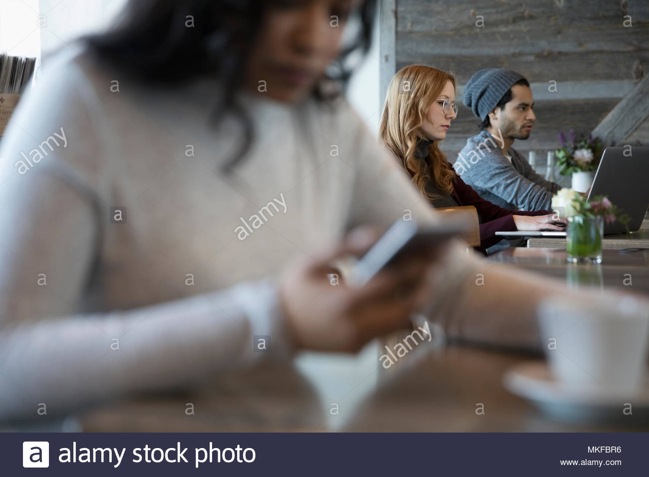 People working in cafe - Stock Image