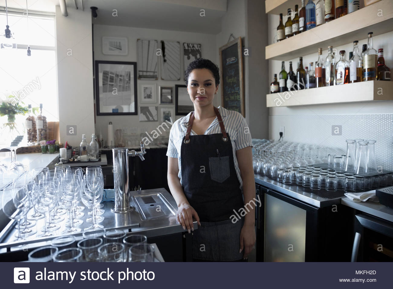 Portrait confident female small business owner working in bar Stock Photo