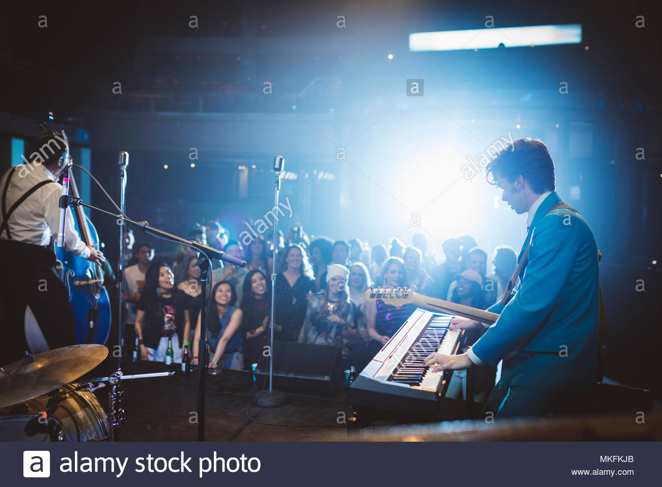 Rockabilly musicians performing on stage at music concert - Stock Image