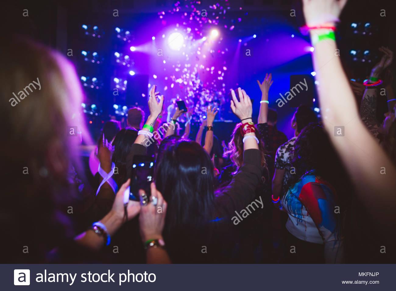 Millennial dancing, partying in nightclub - Stock Image